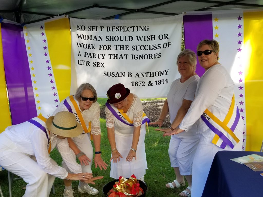 AAUW NC members in period dress as suffragists around a watchfire