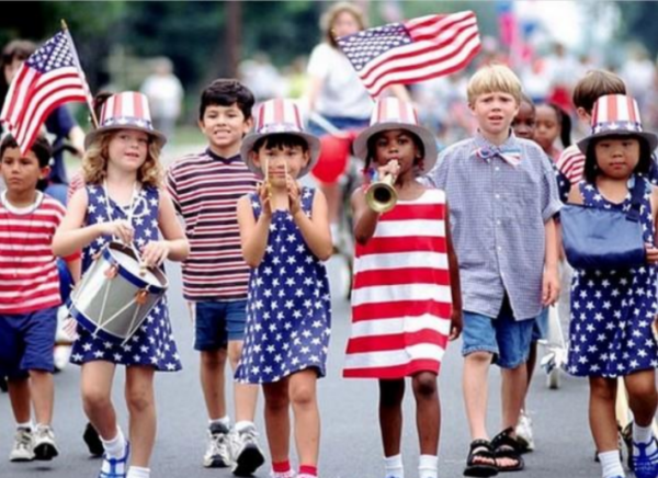 Children marching in red, white and blue
